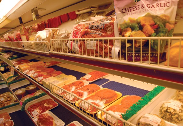 The meat shelves at Ingalls' Six Mile Falls Market display many types of meat and cheeses.