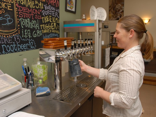 Rebecca Thompson, the assistant brewer at Black Bear Brewery, pours a mug of Webster Side ESB (extra special bitter) beer at the company's taproom.