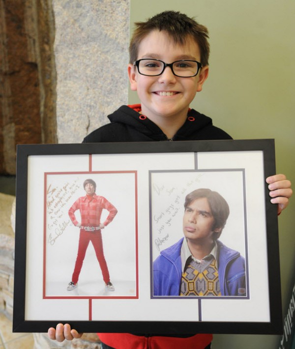 Sam Woodward, 11, who wants to be an astrophysicist, receives a photo gift and message from the actors of the Big Bang Theory.