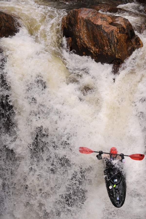 Jeremy Cass runs the 20-foot-high drop at Smalls Falls on the Sandy River during the Smalls to the Wall steep creek kayak race in Township E on Saturday, April 19.  The race course was only about 1/8th of a mile long, competitiors had to negotiate five of the six waterfalls dropping about 60 vertical feet between the start and finish.