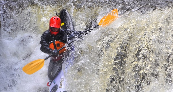 Simon Labbe negotiates one of the drops at Smalls Falls on the Sandy river during the Smalls to the Wall steep creek kayak race in Township E on Saturday, April 19, 2014.