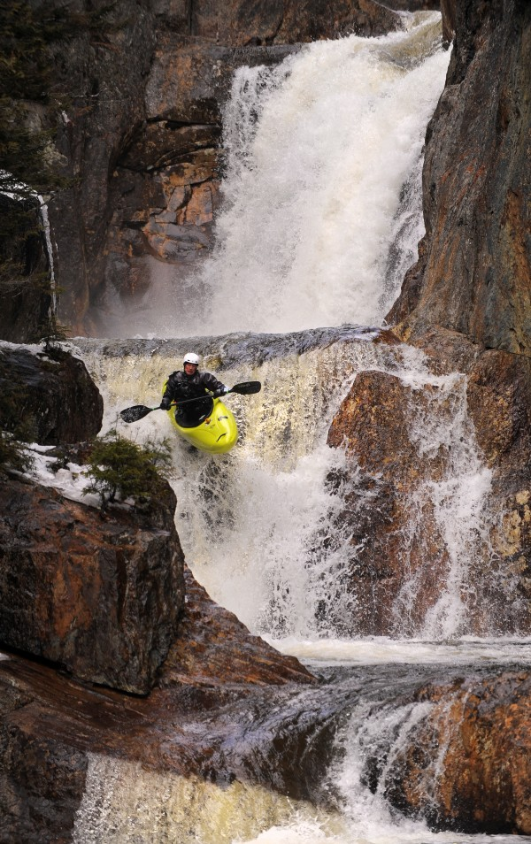 Jeffrey Tillinghast negotiates one of the six drops of Smalls Falls on Sandy River during the Smalls to the Wall steep creek kayak race in Township E on Saturday, April 19. The three drops pictured total about 38 feet in height.