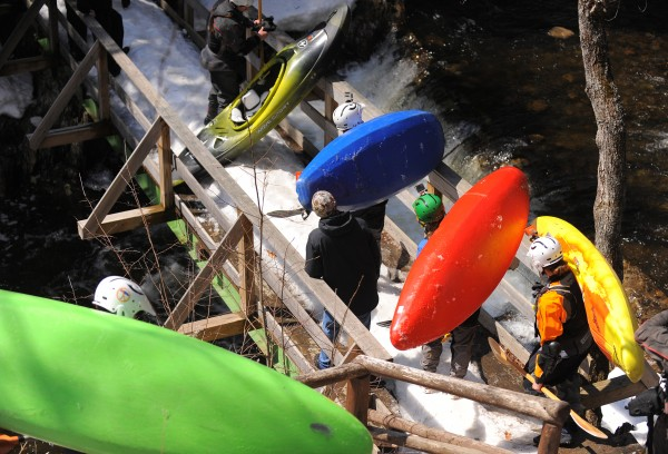 Kayakers make their way to the top of Smalls Falls on the Sandy River before the Smalls to the Wall steep creek kayak race in Township E on Saturday, April 19.
