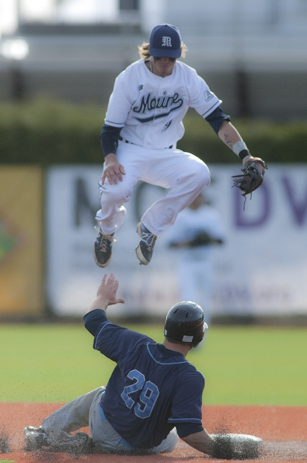 Maine shortstop Shane Bussey (9) leaps over a sliding Nick Sebastian (29) from N.Y.I.T. who steals second in the second inning of their game at Mahaney Diamond in Orono, Maine, Friday, April 25, 2014.
