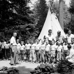 These nineteen members of the Woodchucks, who are attending the YMCA's Camp Prentiss, stood inspection Thursday, June 30, 1960, before the camp was open for visitors' day. The boys, ages 8 to 12, are, left to right, James Richter, Irving Alpert, Brian Strair, Paul Kelley, Greg Mullins, Mark Freedman, Paul Tardiff, Bruce Berry, Terry Turner, Brian Lenfest, Alan Rohay, Wendall Atkinson, Philip Harley, Richard Grove, Delis Lane, Wayne Taylor, Richard Weston, Mark Miller and David Brounstein. The three instructors in back are, Robert Kelley, assistant camp director; George Banks and James Willey. Standing, left front, is David Fox. Sitting, front right is William Wilson.