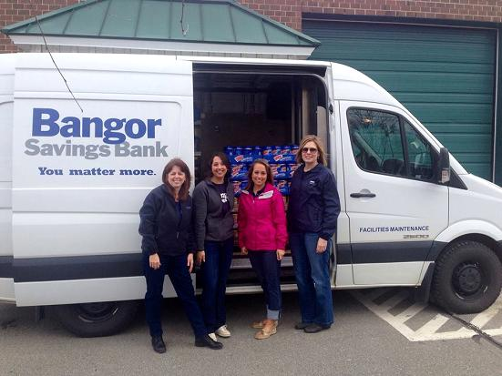 Bangor Savings Bank's Community Outreach team delivering 1,200 jars of peanut butter to food pantries in Lincoln, Old Town, Bangor, Augusta and Portland. Photographed from left: Lisa Bird, Alison DeFilipp, Jillian Rich and Stacy Haskell.