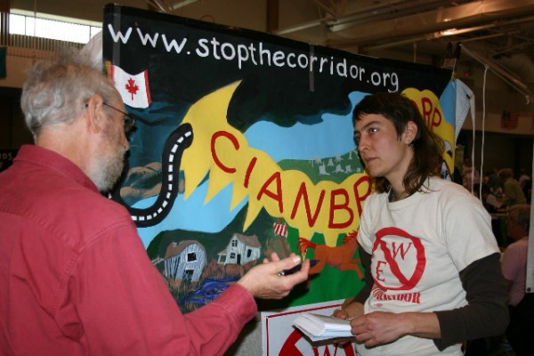 Chris Buchanan, representing StoptheCorridor.org,  listens to a festival attender voice his opinion during HOPE Festival 2014.