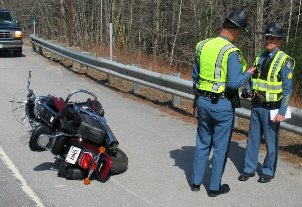 Maine State Police Trooper Chris Smith, left, speaks with Sgt. Alden Bustard on Monday afternoon at the scene of a motorcycle accident on Route 1 in Hancock. The motorcycle operator was taken by Lifeflight helicopter to Eastern Maine Medical Center in Bangor after he slid into the guardrail, was ejected, and tumbled 40 feet down a grassy embankment. The motorcycle came to rest a several feet down the road.