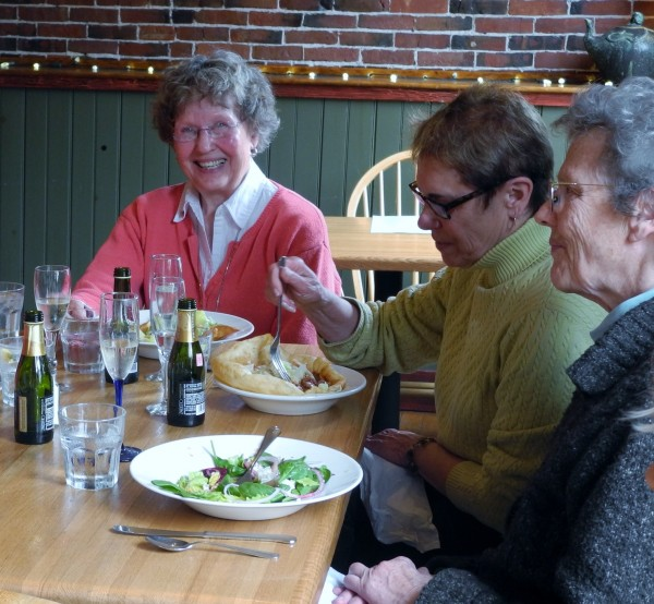 Patricia Hustus (left) laughs this week during a farewell lunch thrown by the three community organizations for which she volunteers. Next to her are Carol Good (center) of the Belfast Parks and Recreation Commission and Lilias Outerbridge of the Belfast Maskers.