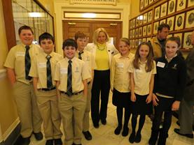 St. John Catholic School students on Jan. 30 served as Honorary Pages for the Senate, and on March 18, they served the House of Representatives. Here are Jake Suttie, Chris Phair, Austin Soucy, Adam Terry, Rep. Nadeau, Emilee Theriault, Elsie Suttie, Sadie Irza.