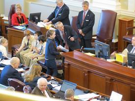 St. John Catholic School students on Jan. 30 served as Honorary Pages for the Senate, and on March 18, they served the House of Representatives. Here, Sadie Izra is talking to a page helper.