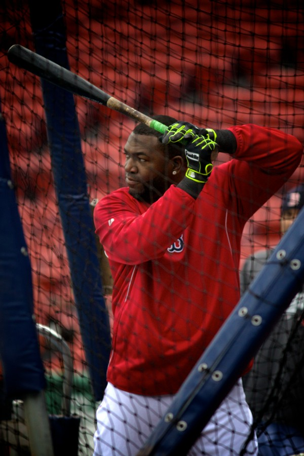 Boston Red Sox slugger David Ortiz takes batting practice Tuesday at Fenway Park. Volunteers of America action teams from four Maine high schools were on hand to watch the Sox beat the Tampa Bay Rays 7-4.