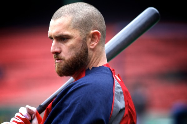 Red Sox left fielder Johnny Gomes shoulders his boomstick during batting practice at Fenway Park on Tuesday. Volunteers of America action teams from four Maine high schools were on hand to watch the Sox beat the Tampa Bay Rays 7-4.