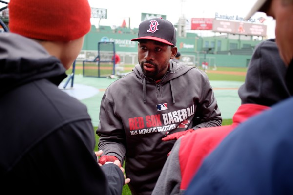 Boston Red Sox center fielder Jackie Bradley Jr. signs autographs during batting practice Tuesday at Fenway Park. Volunteers of America action teams from four Maine high schools were on hand to watch the Sox beat the Tampa Bay Rays 7-4.