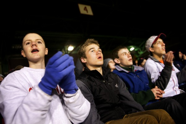 Brunswick High School Volunteers of America action team members (from left) Lincoln Sullivan, Chris Glover, Jesse Devereaux and Donny Shea watch a ball sail towards the Green Monster at Fenway Park in Boston on Tuesday.