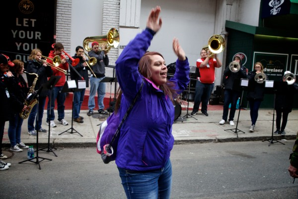 Ariel Gregory, a sophomore at Poland Regional High School, dances with a brass band outside Fenway Park in Boston on Tuesday. Gregory, and her Volunteers of America action teammates were on a trip to see a Red Sox game courtesy of Moody's Collision Center and the Major League Baseball Players Trust.