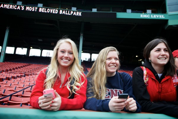 Thornton Academy students (from left) MacKenzie Foley, Hannah Murphy and Lindsey Hall watch the Boston Red Sox take batting practice on Tuesday at Fenway Park. Volunteers of America action teams from four Maine high schools were treated to a baseball game by Moody's Collision Center and the Major league Baseball Players Trust.