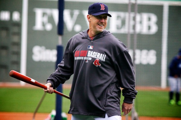Standish resident and Boston Red Sox third base coach Brian Butterfield flashes a smile at the end of batting practice on Tuesday at Fenway Park. Volunteers of America action teams from four Maine high schools were on hand to watch the Sox beat the Tampa Bay Rays 7-4.