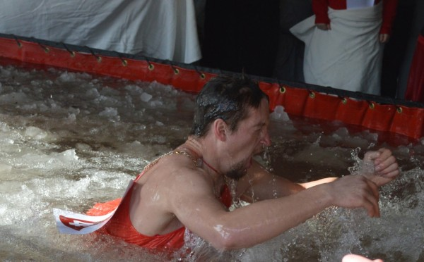 Kyle Washington emerges from the icy pool at TAMC's community Red Dress Race and Polar Dip back in February. Washington believes that community events such as this have played a pivotal role in his lifelong journey to fitness