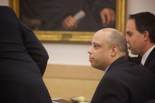 Randall Daluz, 36, of Brockton, Massachusetts, is seated after entering a courtroom at the Penobscot Judicial Center in Bangor for his and Nicholas Sexton, 33, of Warwick, Rhode Island's trial after being accused of the murder of three people and setting their car containing the bodies on fire in August 2012.