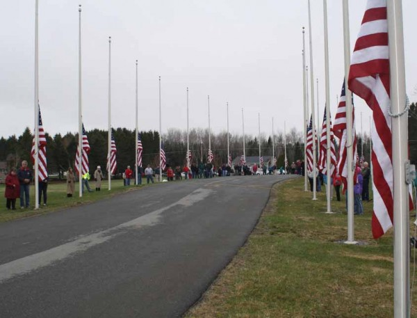 Thirty American flags were raised in honor of deceased veterans during the annual flag-raising ceremony on May 12 at the Northern Maine Veterans Cemetery in Caribou. All of the flags will be flown 24 hours a day, until after Veteran's Day.