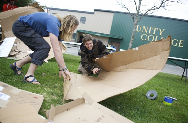 Benjamin &quotSunshine&quot Gardener (left) and Devin Frost build a cardboard kayak to race in the second annual Unity College Cardboard Kayak Race at Unity College.
