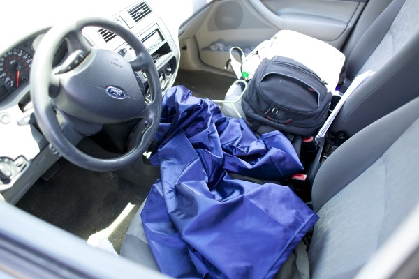 A graduation gown lies on the front seat of Josiah Corbin's Ford Focus. Corbin, who soon will graduate from the University of Maine, has slept in his car several days a week for the last four years of school. Corbin's parking lot of choice has been the Bangor Walmart lot and it saved him tens of thousands of dollars in UMaine resident fees.