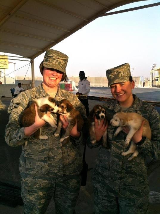 Davielle Rogers, left, with a fellow Air Force airman worked with the local humane society to rescue puppies found at their base in Afghanistan.