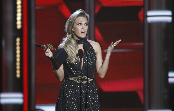 Singer Carrie Underwood accepts the milestone award onstage at the 2014 Billboard Music Awards in Las Vegas, Nevada May 18, 2014.
