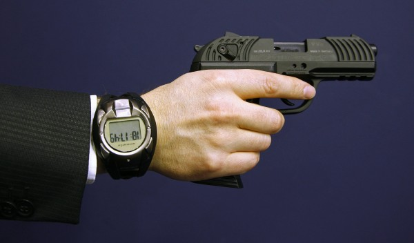 A man holds a prototype of a smart gun by Armatix during the International Guns Exhibition in Nuremberg in 2009.