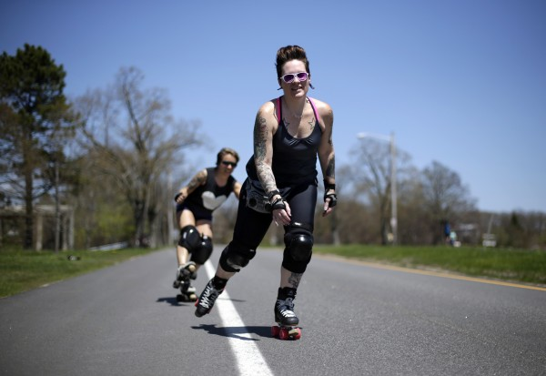 Former roller derby stars Amy Martin (front) and Donna Hickey skate on Baxter Boulevard on Sunday, May 11, 2014, in Portland, Maine.