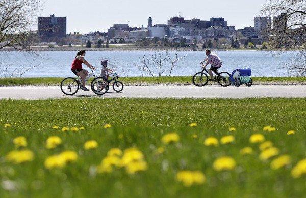 A family enjoys a ride on car-free Baxter Boulevard on Sunday, May 11, 2014, in Portland, Maine.