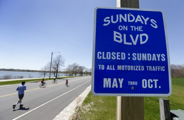 Joggers and bicyclists take advantage of the open road May 11 on the Boulevard in Portland, Maine.