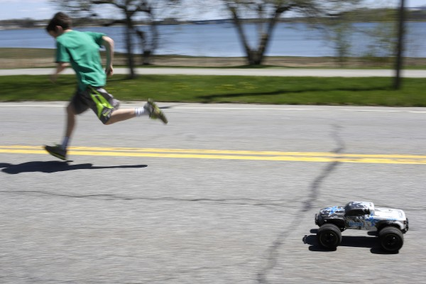 Nick McGonagle races the only truck on the road, a remote-controlled toy operated by a friend on Baxter Boulevard.