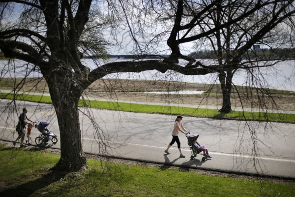 Billie and Ward Libby push strollers during an outing with their children on Baxter Boulevard on Sunday morning.