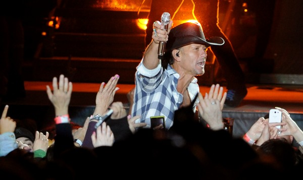 Tim McGraw has fans sing with him during his concert at Darling's Waterfront Pavillion on Thursday night.