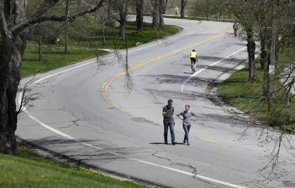 A couple walks along Baxter Boulevard on May 11.