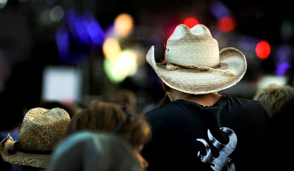 Fans in cowboy hats watch Kip Moore perform at Darling's Waterfront Pavillion on Thursday night before Tim McGraw.