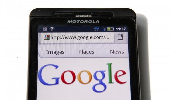 A Google homepage is displayed on a Motorola Droid phone in Washington in this August 15, 2011 file photo.