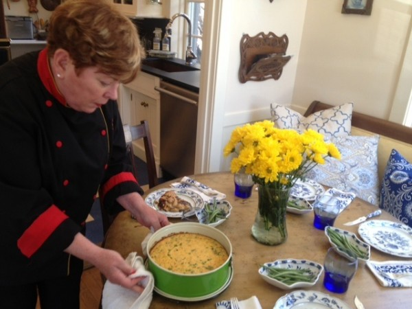 Chef Nancy Cerny of The CVC Catering Group prepares spring pea and ricotta torte with lemon and mint in an Western Promenade kitchen featured this weekend on Portland Kitchen Tour.