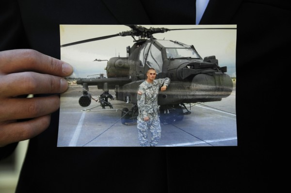 Benjamin Hawthorne holds a picture of his stepbrother, Capt. John &quotJay&quot Brainard III. Hawthorne talked with the BDN Thursday, June 14, 2012, shortly after his brother's remains were returned home in Newport, Maine. Capt. Brainard, an Army pilot, was killed in a helicopter crash in Afghanistan on Memorial Day.