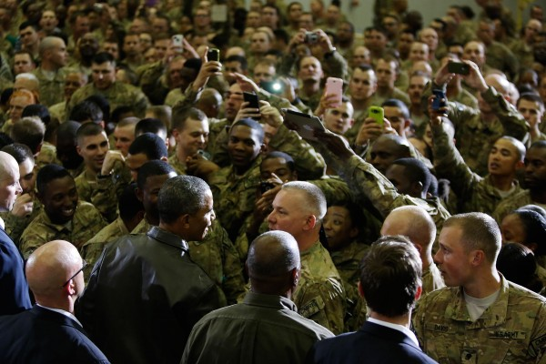 U.S. President Barack Obama shakes hands with troops after delivering remarks at Bagram Air Base in Kabul, May 25, 2014.