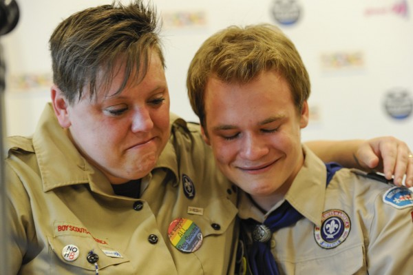 Jennifer Tyrrell (L), who was removed from her position as a den leader in 2012 for being gay, hugs Pascal Tessier, 16, after a resolution passed to allow openly gay scouts in the Boy Scouts of America at the Boy Scouts' National Annual Meeting in Grapevine, Texas in this May 23, 2013, file photo.