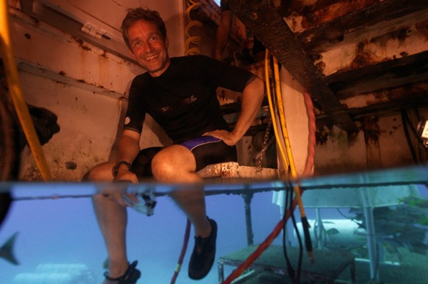 Fabien Cousteau, grandson of Jacques-Yves Cousteau, sits in the Aquarius habitat located 63 feet below the surface of the ocean near the deep coral reef in the Florida Keys National Marine Sanctuary, Florida, in this undated handout picture provided by Mission 31. On June 1, Fabien Cousteau will descend to Aquarius for one month.