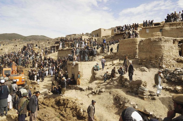 Afghan villagers gather at the site of a landslide at the Argo district in Badakhshan province on Saturday. Afghan officials gave up hope of finding any survivors and focused their efforts on the more than 4,000 people displaced.