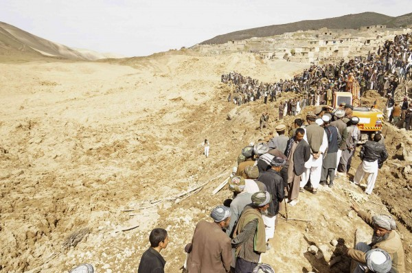 Afghan villagers gather at the site of a landslide at the Argo district in Badakhshan province on Saturday. Afghan officials put the death toll at more than 2,100.