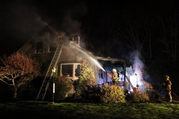 Rockport firefighters assisted by a crew from Rockland battled a fire at a Rollins Lane home shortly before 12:30 a.m. Thursday.
