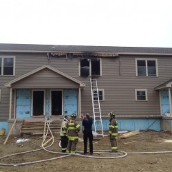 Hampden woman jumps from second-story window to escape fire