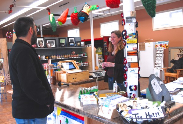 Stacy Martin, general manager at the Market Street Co-op in Fort Kent, spends a few moments with building owner Dr. Rod Lahren discussing future plans for the business and property.
