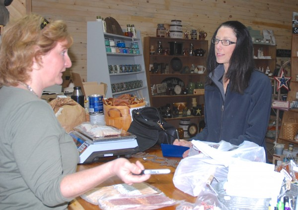 Kara Beal (right) talks over local produce and food with Janice Bouchard at Bouchard's Country Store this weekend. &quotI like to know where my good is coming from and I want to support local farmers,&quot Beal said.
